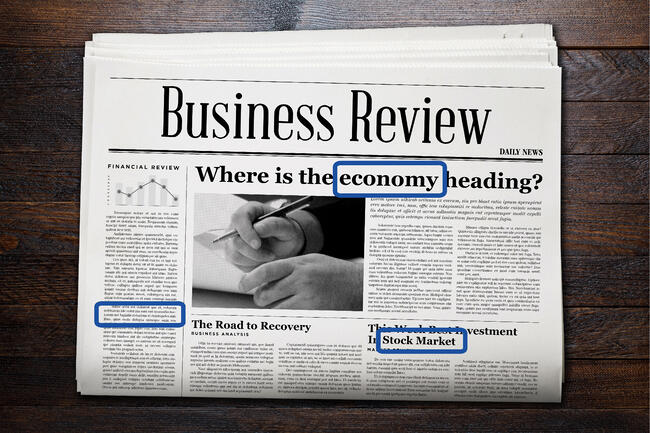 Photo of a business review newspaper where topic analysis NLP technique has been applied to highlight recurrent themes in the text, in this case, those related to economic recovery.