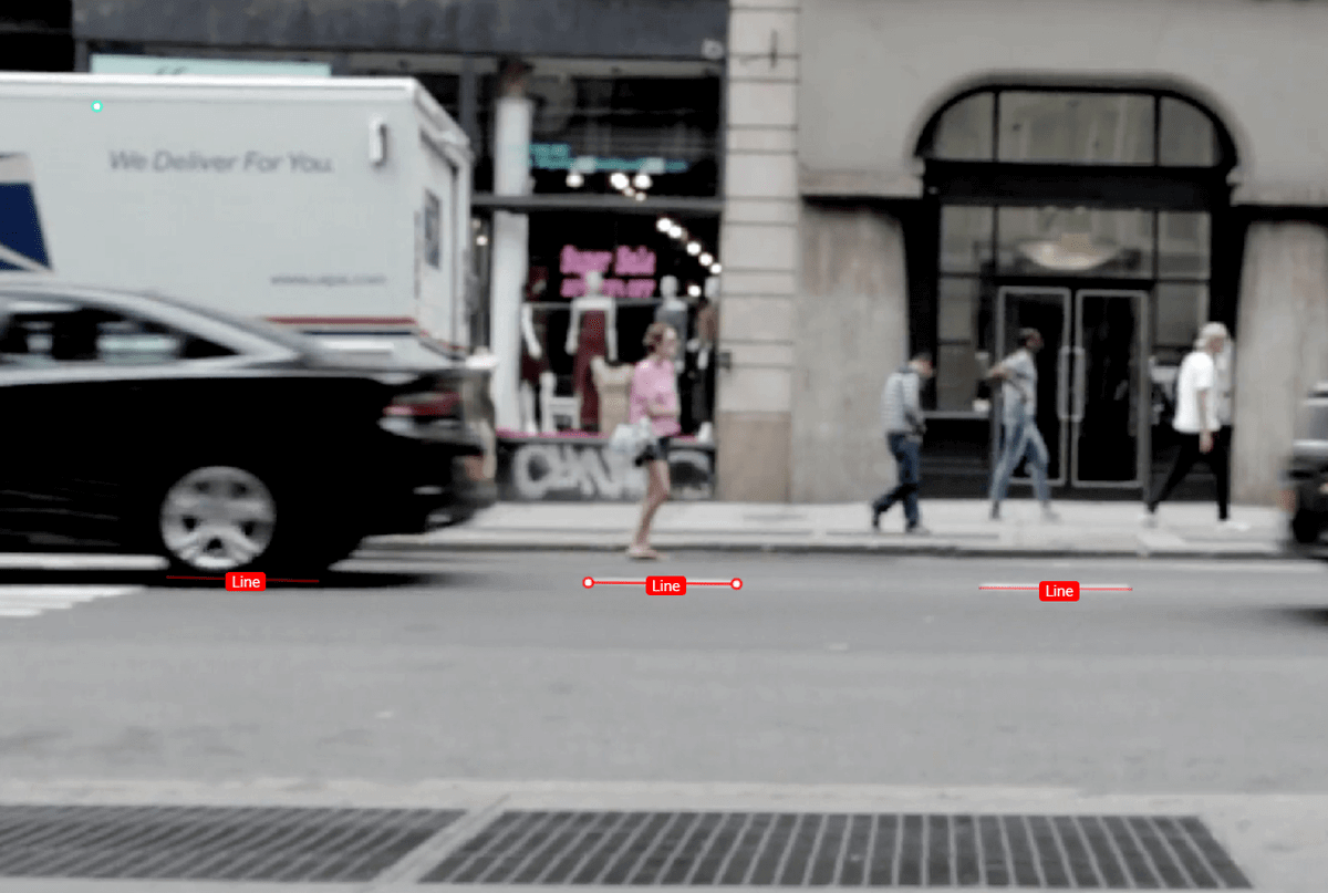 This is an example of image annotation using a polyline. It is an image of a street scene. The street's lane line is the object of interest, and it is annotated with line segments that are labeled.